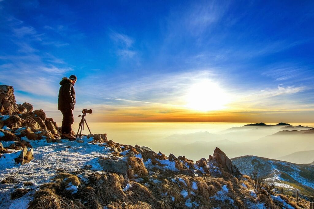 a photographer shooting on the mountains